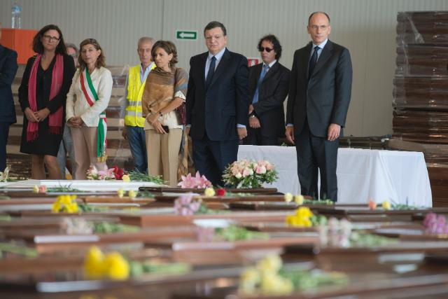 Enrico Letta, 1st, José Manuel Barroso, 2nd, Giusi Nicolini, 4th, and Cecilia Malmström, 5th, paying tribute to the victims, in front of their coffins (in the foreground, from right to left)
